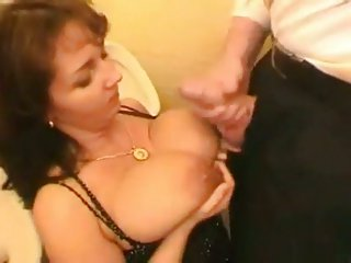 Chubby milf with huge tits banged in the WC