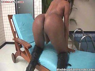 Brazilian shemale wanks her dick
