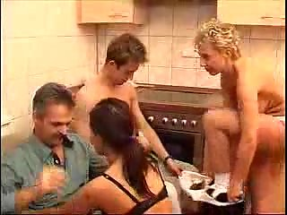 Family group fucking in the kitchen