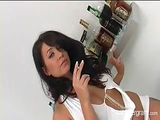 Smoking brunette pleased by two dicks