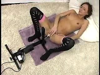 Skinny girl testing sex machines at doctor