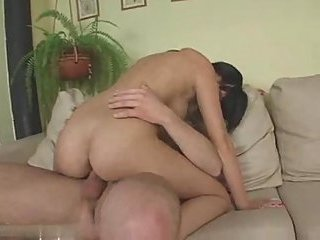 Nude brunette takes hot cum after fuck on sofa