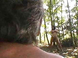 Old man making out with cutie in forest