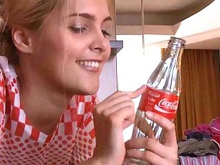 Blond teen teasing with bottle