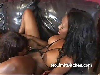 Lesbian Candice licks busty ebony girl pussy