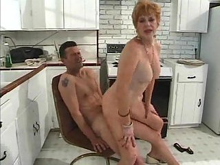 Horny granny banged in the kitchen