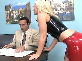 Footsex in latex boots in office