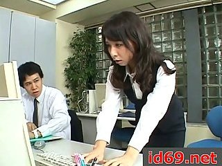 Japanese slut blows cock in office