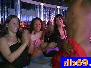 Girls take turn sucking stripper