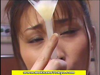 Japanese cutie drinking cum through a funnel