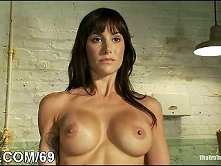 Busty naked brunette chained