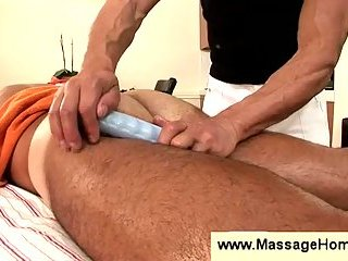 Masseur uses vibrator to tease butthole