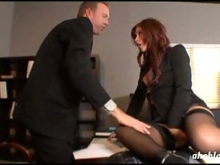 Redhead babe nailed in office