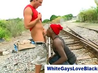 Interracial gay blowjob outdoors