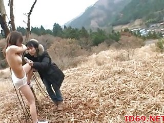 Japanese teen sucks outdoor