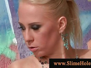 Blonde at a gloryhole playing with cock