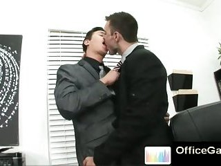 Sexy stylish gay studs at office kissing