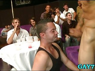 Kneel and suck gay cock at party