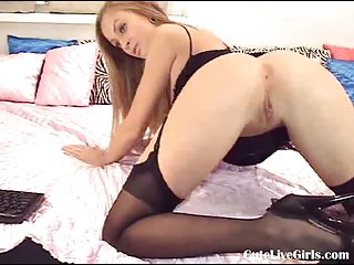 Hot and sexy girl playing with her boobs
