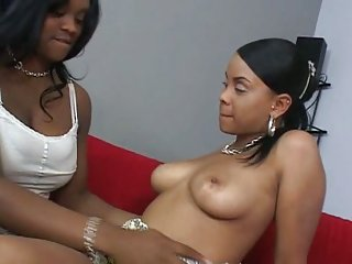 Ebony lesbos give pussy licking to each other
