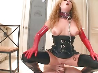 Redhead analed in boots, corset and latex gloves