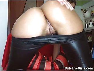 Brunette having fun in latex