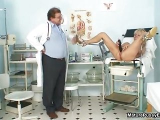 Horny mature patient toying her pink pussy