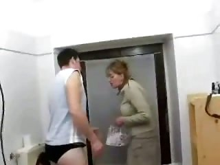 Older Mom and Son in Toilet