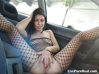 Brunette having fun with her pussy in the car