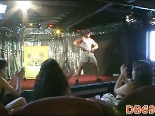 Girl gives blowjob to ebony stripper