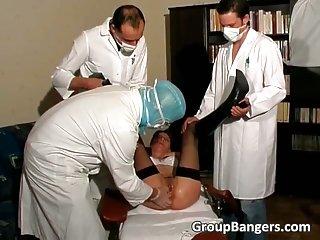 Three horny doctors fuck this slut in her ass
