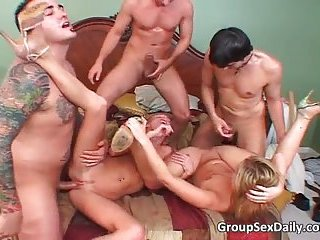 Amazing group sex party on the bed with two hot chicks