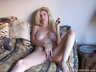 Beautiful blonde mature enjoys a smoke break