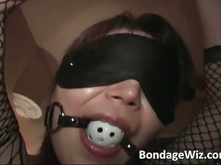 Tied up Asian slut sucks and fucks some guy on the bed