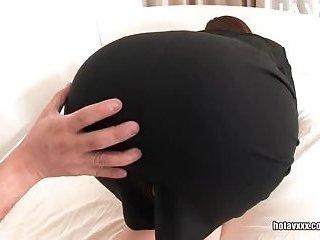 Pantyhose clad slut gives footjob