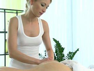 Blonde masseuse giving handjob