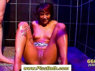 Girl showered in golden piss