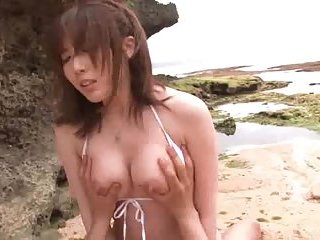 Busty Japanese fucked from behind on the beach