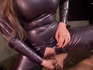 Babe In Latex Riding Dick