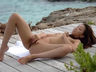 Asian angel finger by the ocean