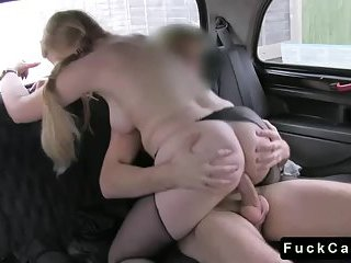 Busty blonde drills driver in his fake taxi