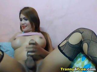 Busty Tranny Strokes her Big Hard Dick