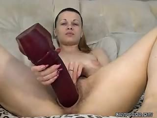Hairy milf fists and drills herself with huge toy