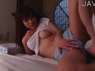 Busty brunette masturbates while her husband is sleeping