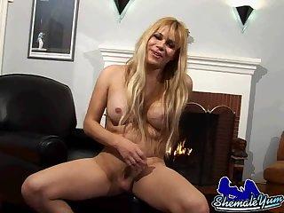 Hot blonde shemale masturbates cock