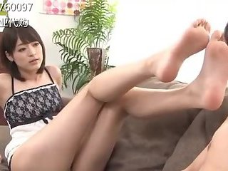 Tall Japanese girl gives footjob