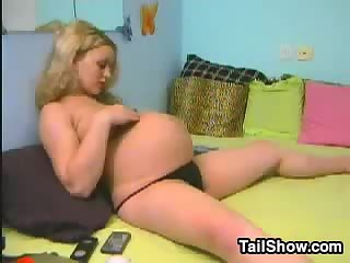 Pregnant Blonde Chick shows her boobs