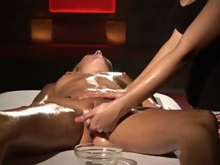 Blonde receives water and oily massage orgasm