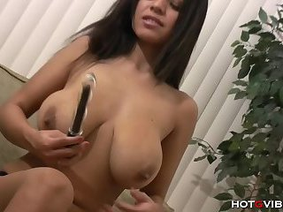 Big tits brunette empales herself on a dildo