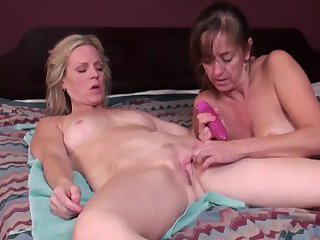 Mature blonde and brunette playful toy lesbians